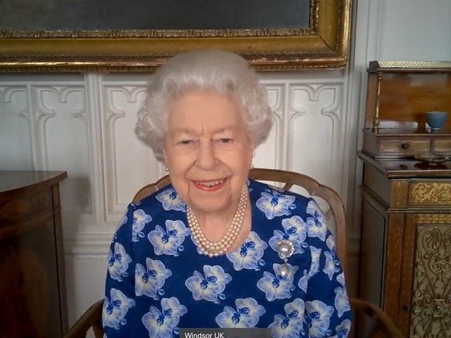 Queen Elizabeth II during a video call with the Duchess of Cornwall to thank volunteers from the Royal Voluntary Service (RVS)