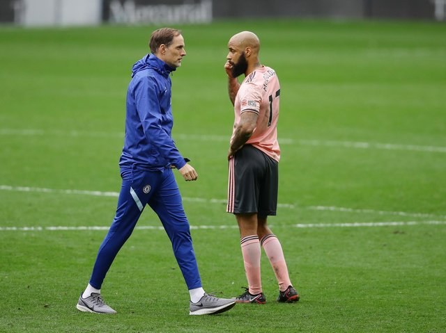 MISS: David McGoldrick ponders defeat at full-time. The Sheffield United striker missed a great chance to potentially take Thomas Tuchel's Chelsea to extra-time
