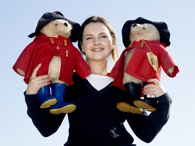 Pictured Charlotte Trueman, with Lot 148, Two Gabrielle Designs Paddington Bears, H52cm. Image: James Hardisty