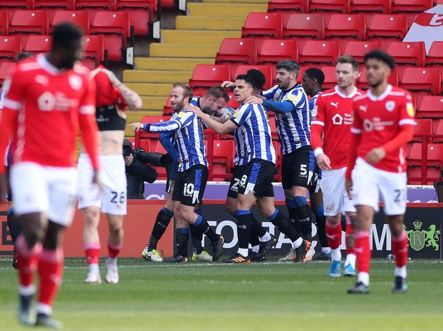 Sheffield Wednesday players celebrate Jordan Rhodes's opener at Oakwell. Picture: PA.