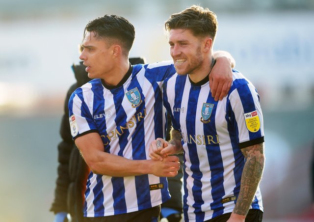 Victory: A win at last for delighted Joey Pelupessy and Josh Windass. Pictures: Steve Ellis