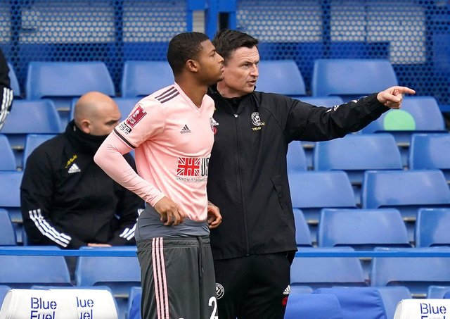 Sheffield United interim manager Paul Heckingbottom, right, gives instructions to Rhian Brewster at Stamford Bridge. Picture: John Walton/PA