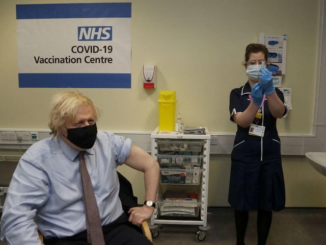 Prime Minister Boris Johnson prepares to receive the first dose of AstraZeneca vaccine administered by nurse and Clinical Pod Lead, Lily Harrington at Westminster Bridge Vaccination Centre at St Thomas' Hospital in London. Picture: Aaron Chown/PA.