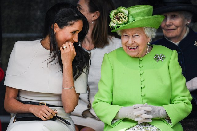 Queen Elizabeth II sitts and laughs with Meghan, Duchess of Sussex during a ceremony to open the new Mersey Gateway Bridge on June 14, 2018 in the town of Widnes in Halton, Cheshire, England. (Photo by Jeff J Mitchell/Getty Images)