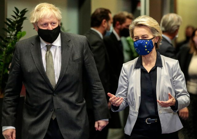 Boris Johnson with European Commission President Ursula von der Leyen  in the Berlaymont building at the EU headquarters in Brussels on December 9, 2020 (Photo by OLIVIER HOSLET/POOL/AFP via Getty Images)