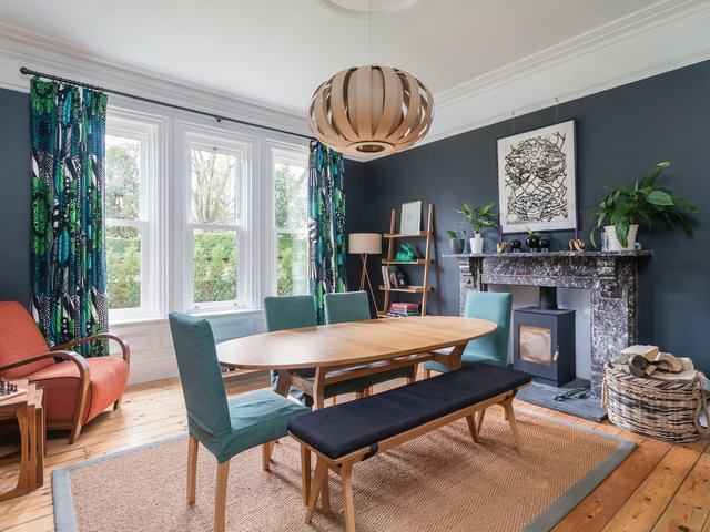 The dining room with Tom Raffield pendant light and curtains in Marimekko fabric