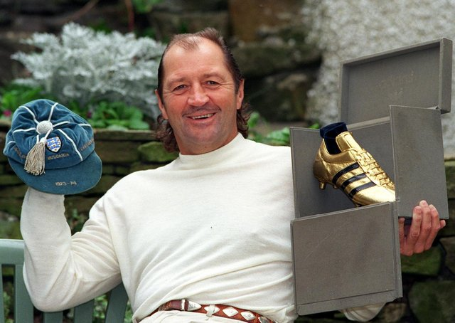 Frank Worthington pictured in 1998 at his Huddersfield home, with one of his England caps from  1973-74 and the  Golden Boot for top scorer in the first division in 1978-79  for Bolton Wanderers.