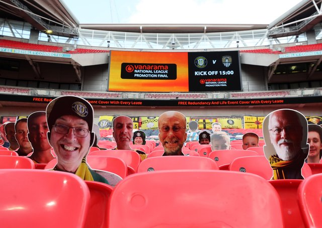 Empty Wembley: Harrogate fans are seen on cardboard cutouts in the empty stands during the Vanarama National League play-off final match between Harrogate Town and Notts County. Picture: Catherine Ivill/Getty Images
