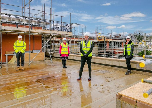 Celebrating the topping out of Springfield's new care home in Harrogate are: L-R Neil Silcock (Simpson), Sally Rasmussen (Springfield Healthcare), Graeme Lee (Springfield Healthcare) and Jo Hawkins-Spencer (Projex Building Solutions).
