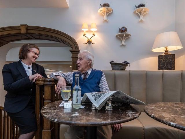A regular customer of Bettys in Harrogate enjoys the hospitality