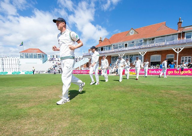 Yorkshire's Steve Patterson leads his side out against Surrey at Scarborough's North Marine Road ground. Picture: swpix.com
