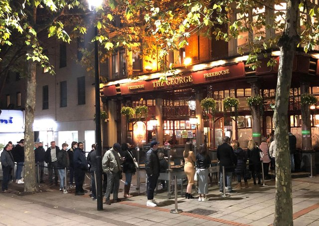 People queuing to get into the The George pub in Wanstead, east London in 2020. Pub landlords could be allowed to require customers to provide proof they are vaccinated against coronavirus, according to Boris Johnson. Picture: Stefan Rousseau/PA Wire