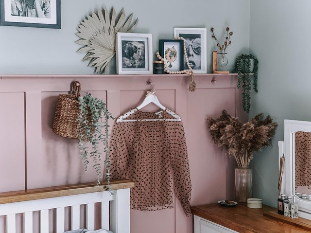 The DIY panelling and shelf in the bedroom