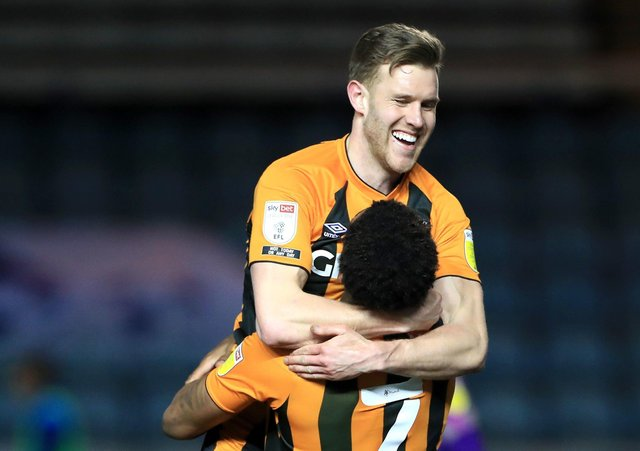 On their way back?: Callum Elder celebrates with Hull City team-mate Mallik Wilks (right), as the Tigers sit top of League One. Picture: PA