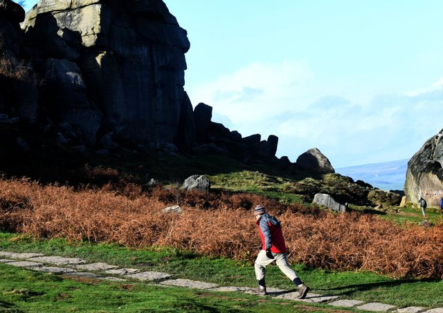 Visitors to the Cow and Calf rocks on Ilkley Moor. Picture: Gary Longbottom