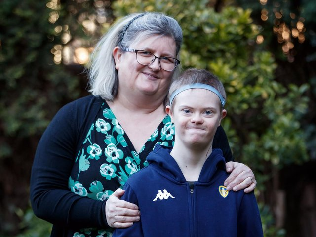 Ann-Marie Sheard with her son Isaac, who has Down Syndrome and is classed as clinically extremely vulnerable (CEV), at their home in Ackworth. PIC: PA