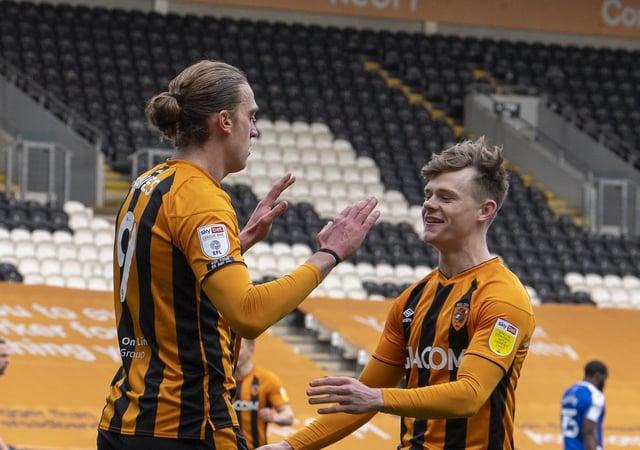On target: Scorer Tom Eaves celebrates with Keane Lewis-Potter. Pictures: Tony Johnson