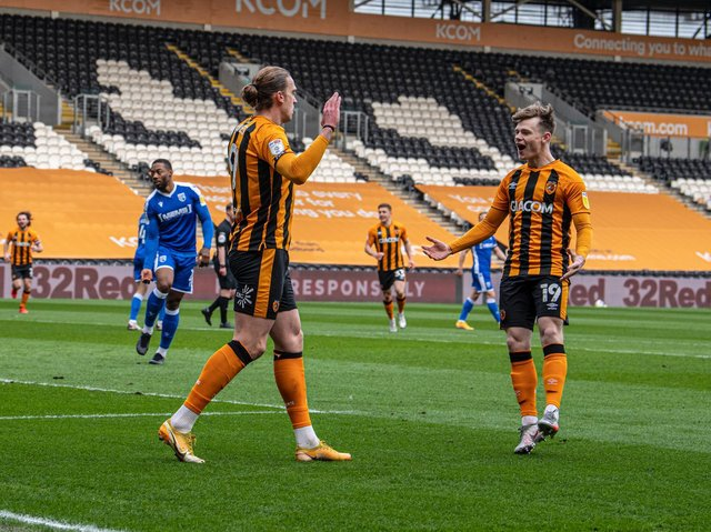 Hull City striker Tom Eaves celebrates his opener with Keane Lewis-Potter. PICTURE: TONY JOHNSON.