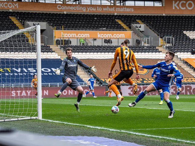 Hull City striker Tom Eaves heads the hosts in front against Gillingham. PICTURE: TONY JOHNSON.