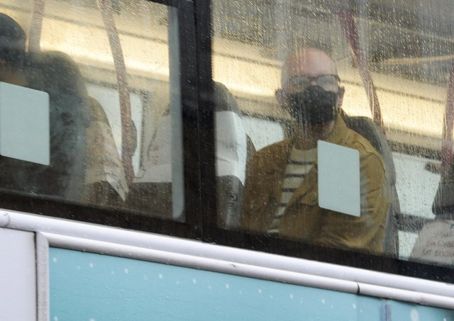 Public transport users in South Yorkshire wearing masks as they travel by bus. PIcture: Dean Atkins