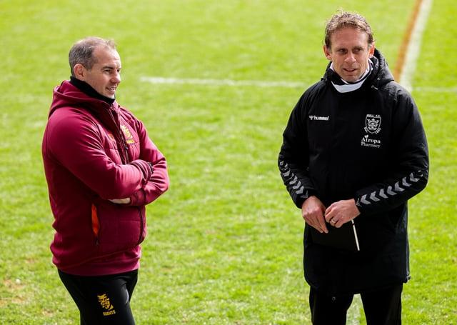 Hull FC head coach Brett Hodgson and Huddersfield head coach Ian Watson.