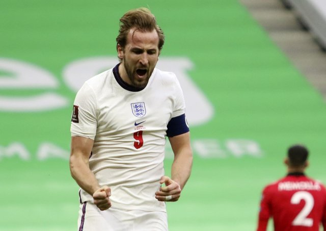 England's Harry Kane celebrates his side's first goal during the World Cup 2022 group I qualifying soccer match between Albania and England at Air Albania stadium in Tirana. (AP Photo/Hektor Pustina)