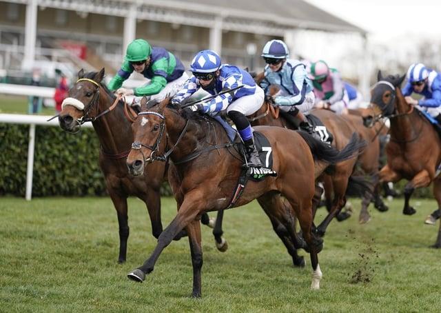 Haqeeqy ridden by Benoit de la Sayette (centre, blue/white) win The Unibet Lincoln at Doncaster Racecourse. Picture: PA.