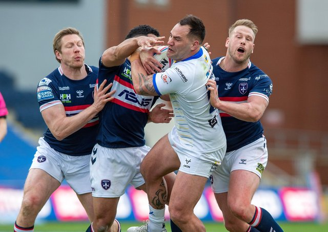 Leeds Rhinos' Bodene Thompson is stopped by the Wakefield defence. on Saturday (Picture: Bruce Rollinson)