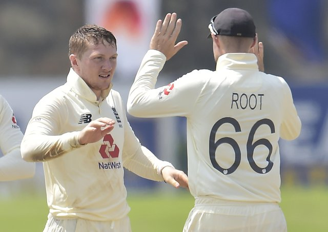 Dom Bess celebrates a wicket with Joe Root on day four of the second Test match between Sri Lanka and England at Galle (Picture: Sri Lanka cricket via ECB)