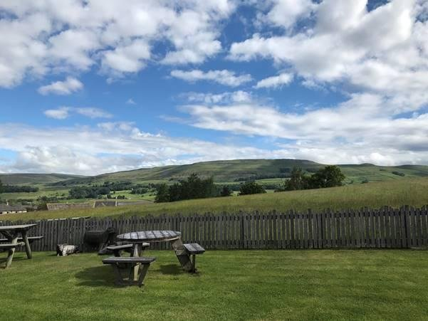 The Wensleydale Creamery garden with views across the Yorkshire Dales
