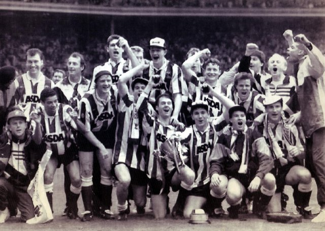 CUP UPSET: A jubilant Sheffield Wednesday team after beating Manchester United 1-0 at Wembley in the Rumbelows League Cup Final - April, 21 1991. Wednesday went on to win promotion at the end of the season 1990-91 season. Picture: Nancy Fielder/PA.