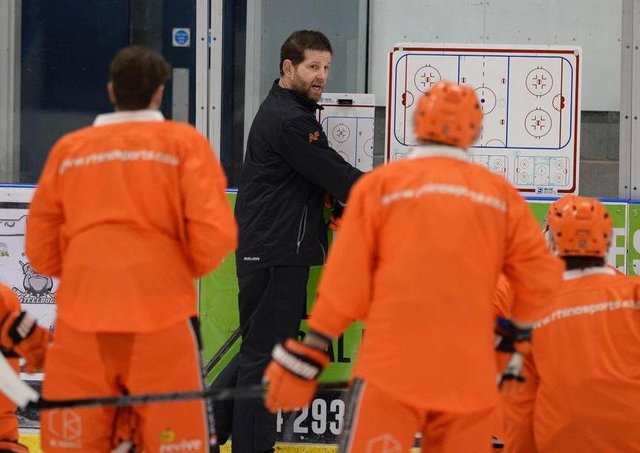 NOW HEAR THIS: Sheffield Steelers' head coach Aaron Fox gives his players some instruction during on-ice practice on Monday. Picture courtesy of Dean Woolley.