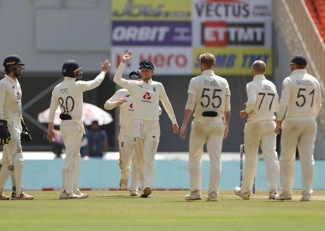 England's Jack Leach and Joe Root celebrate the wicket of Ravichandran Ashwin on day one of the fourth Test match in Ahmedabad. Picture: Saikat Das/Sportzpics for BCCI (via ECB).