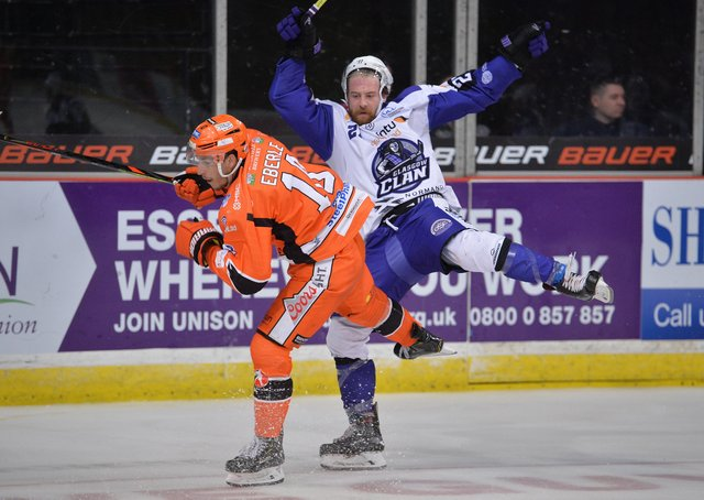 IN THE THICK OF IT: Tanner Eberle makes his presence felt against Glasgow Clan last season, Picture: Dean Woolley.