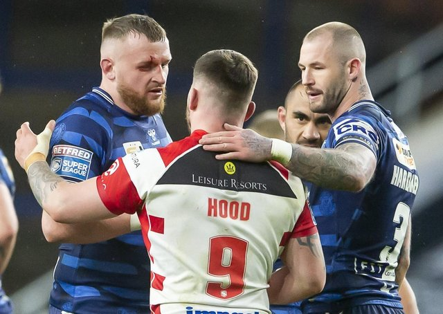 Wigan prop Brad Singleton, left, pictured at the end of last weekend's Super League opener with Leigh Centurions. Picture: Allan McKenzie/SWpix.com.