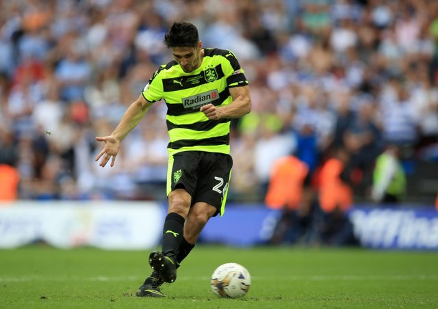 Huddersfield Town's Christopher Schindler scores the winning penalty to take the Terriers into the Premier League in May 2017 (Picture: PA)