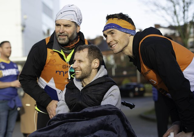 This was Rob Burrow (centre) greeting Kevin Sinfield (right) when the latter ran seven marathons in seven days to raise funds for the MND Association.
