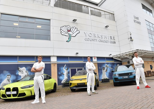 New backers: From left, David Willey, Tom Kohler-Cadmore and Ben Coad with cars from Yorkshire's sponsors.