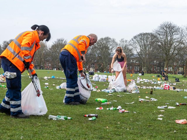 A clean-up operation involving some students, residents and Leeds City Council on Woodhouse Moor, in Headingley, after hundreds of people gathered during the week to enjoy the warm weather. People left behind tons of litter, bottles, food and disposable barbecues. (James Hardisty).