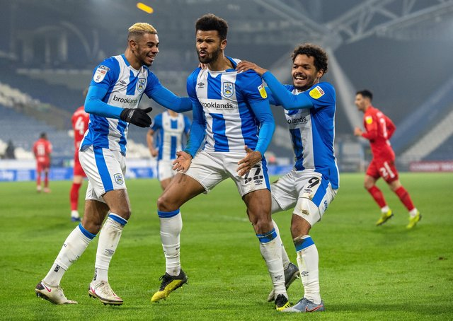Local lads: Fraizer Campbell celebrates scoring against Birmingham with Juninho Bacuna and fellow local Duane Holmes.  Picture: Bruce Rollinson