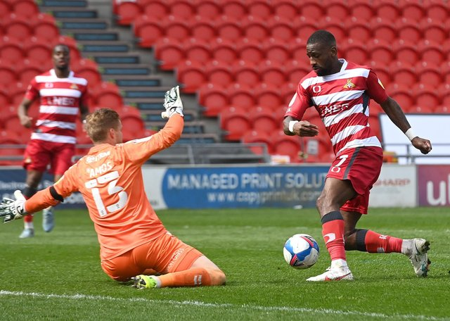 Doncaster's Omar Bogle looks to take the ball round Charlton's keeper Ben Amos (Picture: Andrew Roe/AHPIX LTD)