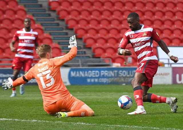 Rare chance: Doncaster Rovers' Omar Bogle attempts to take the ball round Charlton's goalkeeper Ben Amos. Picture: Andrew Roe/AHPIX LTD