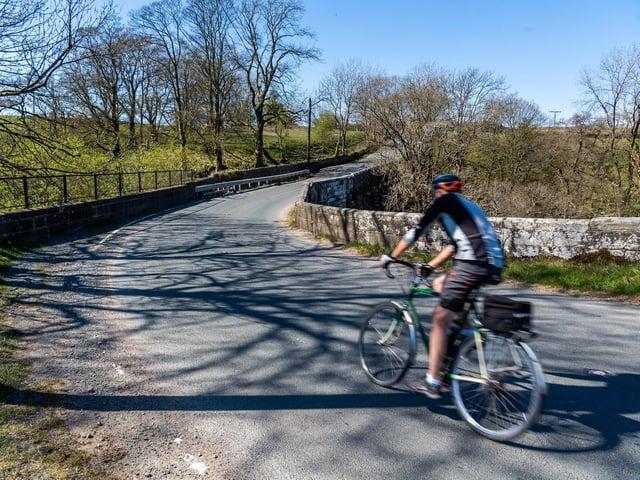 A cyclist at accident black spot Dibbles Bridge, near Grassington, North Yorkshire