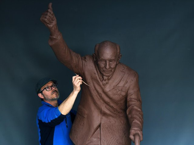 Artist Andrian Melka works on his Captain Sir Tom Moore sculpture at his studio near York. Picture : Jonathan Gawthorpe