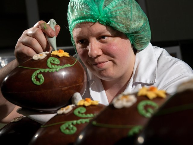 Chocolatier Toni Hughes decorates a chocolate egg for Bettys' Easter range. Staff at the Harrogate business have reported the busiest ever run-in to the Easter weekend. (Photo: Bruce Rollinson).
