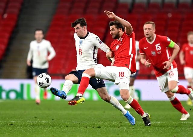 Midfield pic: England's Mason Mount with Poland's Bartosz Bereszynski. Pictures: PA