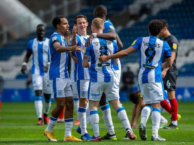 Huddersfield Town goalscorer Lewis O'Brien is congratulated by his team-mates after putting the hosts in front against Brentford. Picture: Bruce Rollinson.