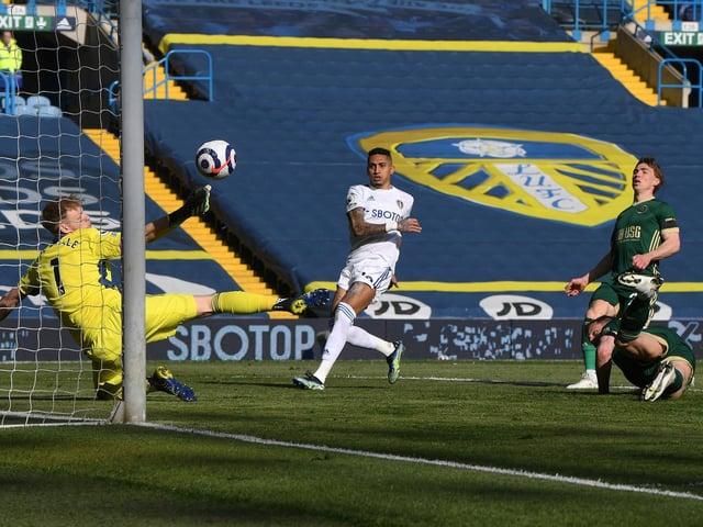 OWN GOAL: Phil Jagielka puts through his own net