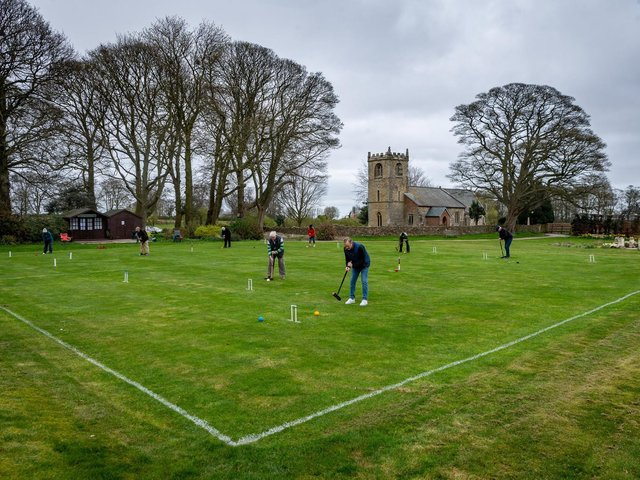 Members of the Beverley & East Riding Croquet Club, were thrilled to be once again practising for their new season at their grounds on the lawns of Rowley Manor Hotel, Little Weighton, Cottingham, near Hull. Pictured Members practising on the lawns with a backdrop of St Peter's Church. Writer: James Hardisty