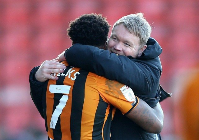 Hull City manager Grant McCann (right) celebrates victory with Mallik Wilks (left). Pictures: PA.
